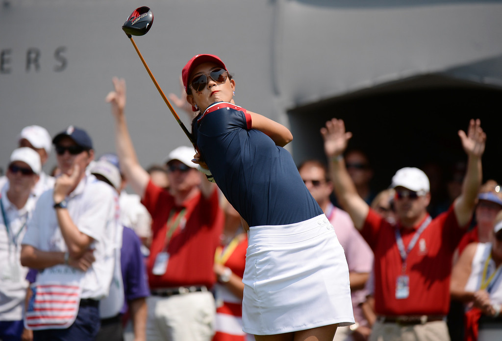 . PARKER, CO. - August 16: Michelle Wie of team USA is watching her ball from 1st tee ground during  2013 Solheim Cup at Colorado Golf Club. Parker, Colorado. August 16, 2013. (Photo By Hyoung Chang/The Denver Post)