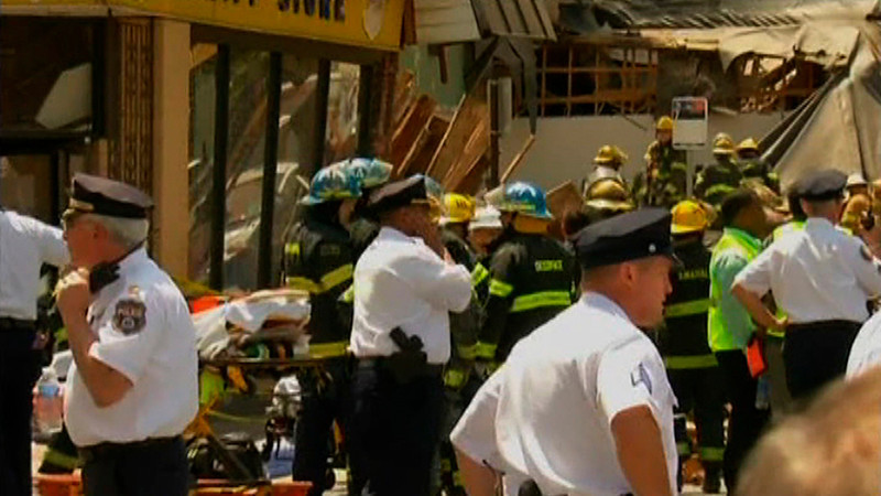 . Rescue workers search through rubble following a building collapse in Philadelphia June 5, 2013, as seen in this still image taken from video courtesy of NBC10.com.   REUTERS/NBC10.com/Handout