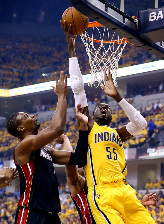 . Roy Hibbert #55 of the Indiana Pacers goes to the basket as Dwyane Wade #3 and Chris Bosh #1 of the Miami Heat defend during Game Two of the Eastern Conference Finals of the 2014 NBA Playoffs at at Bankers Life Fieldhouse on May 20, 2014 in Indianapolis, Indiana.   (Photo by Andy Lyons/Getty Images)
