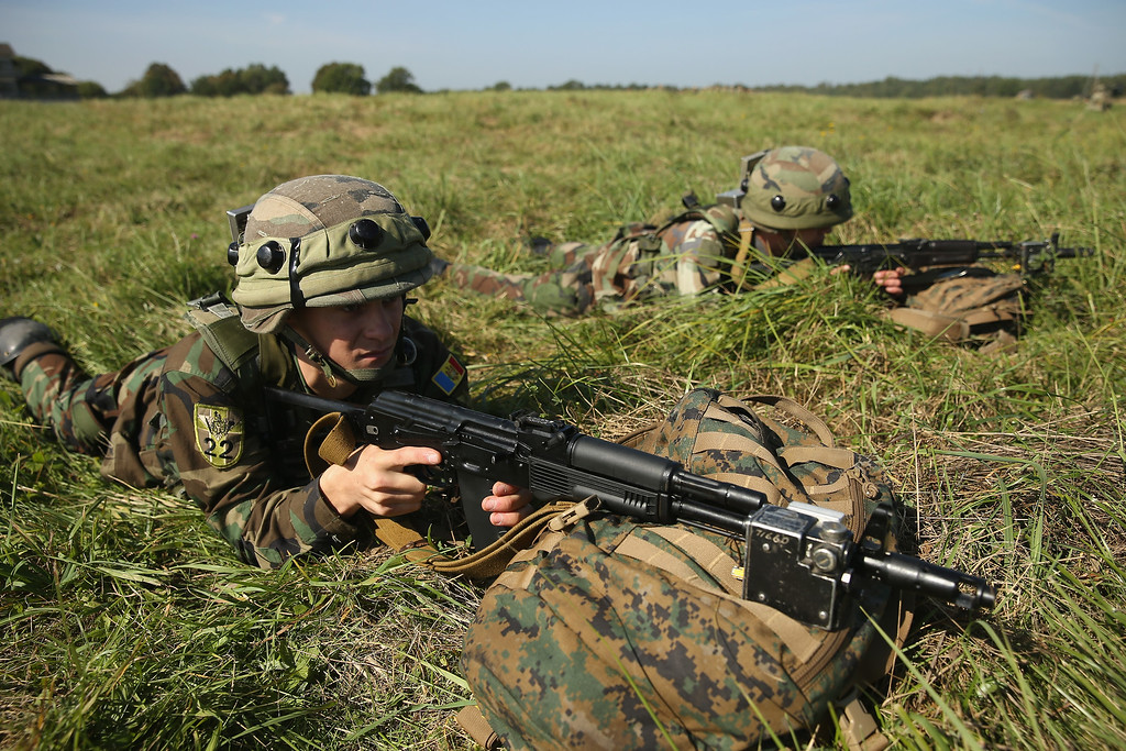 ". Soldiers from Georgia participate in training on the second day of the ""Rapid Trident\"" NATO military exercises on September 16, 2014 near Yavorov, Ukraine.  (Photo by Sean Gallup/Getty Images)"