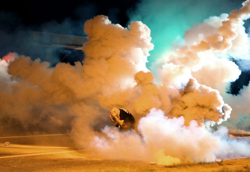 """. <p><b> Hundreds of protesters hit the streets of Ferguson, Mo, again on Tuesday night because � </b> </p><p> A. They�re outraged by the death of Michael Brown </p><p> B. They�re determined to fight for justice </p><p> C. They saw the TV lights were still there </p><p><b><a href=\""""http://www.twincities.com/breakingnews/ci_26348972/rowdy-night-after-another-tense-day-ferguson?source=rss\"""" target=\""""_blank\"""">LINK</a></b> </p><p>    (AP Photo/St. Louis Post-Dispatch, David Carson)</p>"""