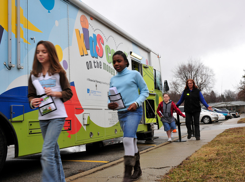 Ashton, 11, and Chyanne, 11, exit the money bus.