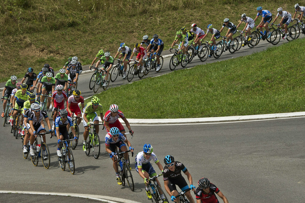 . The pack rides during the 145.5 km eighteenth stage of the 101st edition of the Tour de France cycling race on July 24, 2014 between Pau and Hautacam, southwestern France.  AFP PHOTO / LIONEL BONAVENTURE/AFP/Getty Images
