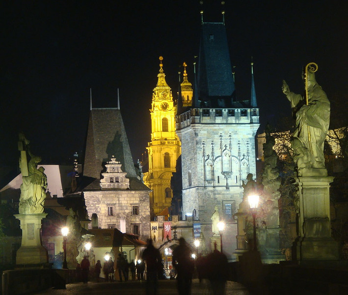 Charles Bridge West Gate by night.JPG