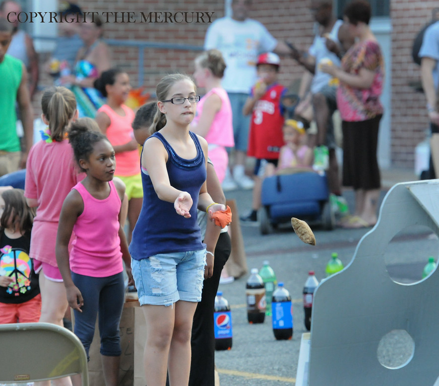 . Kids toss bean bags at First Church of the Brethren at Fifth and York street as part of the National Night Out events held in Pottstown. Photo by John Strickler The Mercury