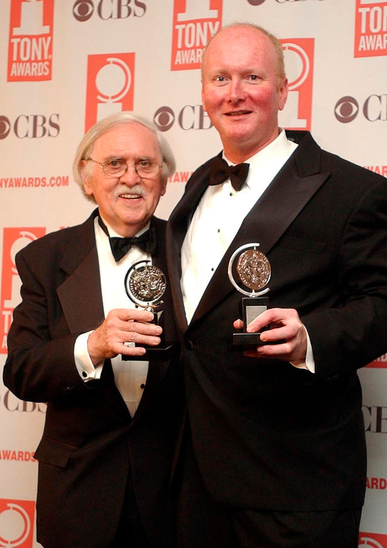 """. FILE - In this June 8, 2003 file photo, Thomas Meehan, left, and Mark O\'Donnell pose with their Tony awards for best book of a Musical for \""""Hairspray\"""" during the 57th Annual Tony Awards at New York\'s Radio City Music Hall. On Tuesday, Aug. 22, 2017, Martin Charnin said that Meehan, the three-time Tony Award-winning book writer, has died. Meehan was 88. (AP Photo/Mary Altaffer, File)"""