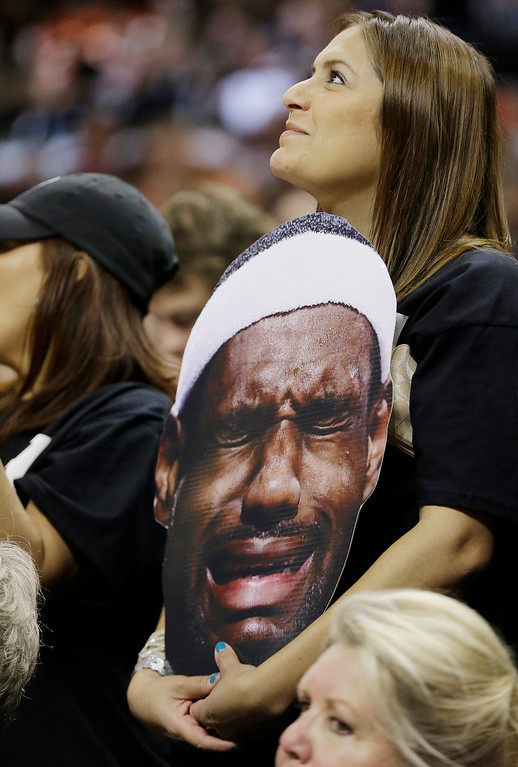 . A San Antonio Spurs fan watches the final minutes against the Miami Heat during the second half at Game 5 of the NBA Finals basketball series, Sunday, June 16, 2013, in San Antonio. The Spurs won 114-104. (AP Photo/Eric Gay)