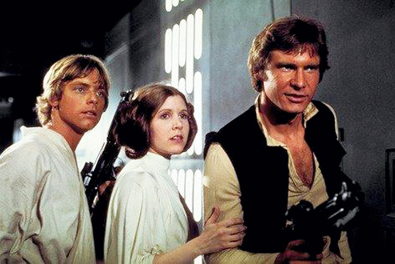 . Mark Hamill as Luke Skywalker, left, Carrie Fisher as Princess Leia Organa, and Harrison Ford as Hans Solo star in the original 1977 �Star Wars: Episode IV � A New Hope.� The Cleveland Orchestra presents �Star Wars: A New Hope In Concert - Live� from Aug. 31 through Sept. 2 at Blossom Music Center. The film will be shown as the orchestra plays the original score. Fireworks will follow the concert, weather permitting. For more information, visit clevelandorchestra.com.  (Twentieth Century Fox Home Entertainment)