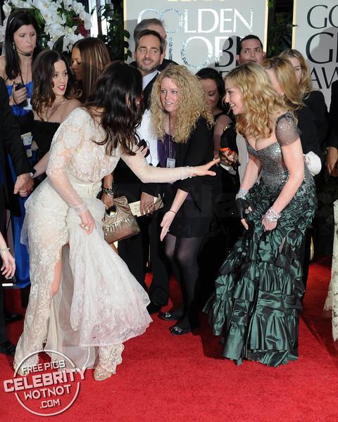 Madonna Steps on Jessica Biel's Dress At The Golden Globes!