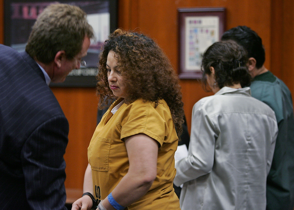 . Anna Ayala, center left, talks with her attorney, Rick Ehler, far left, as her husband, Jamie Placencia, far right, talks with an interpreter, in a San Jose, Calif. courtroom, Friday, Sept. 9, 2005 before they pleaded guilty of all charges related to planting a human finger in a bowl of Wendy\'s chili. Ayala and Placencia both pleaded guilty on Friday to conspire to file a false claim and attempting grand theft from the fast food restaurant chain. (AP Photo/Paul Sakuma)