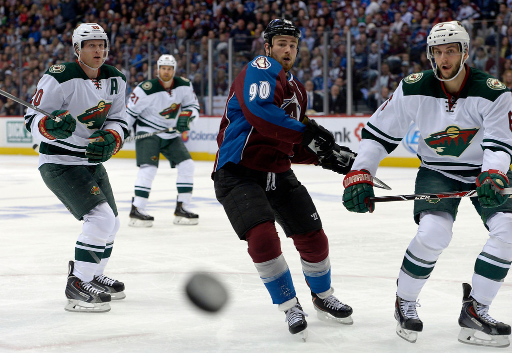 . Ryan O\'Reilly (90) of the Colorado Avalanche keeps an eye on the puck in the Minnesota zone during the first period of action. The Colorado Avalanche hosted the Minnesota Wild in the first round of the Stanley Cup Playoffs at the Pepsi Center in Denver, Colorado on Saturday, April 19, 2014. (Photo by John Leyba/The Denver Post)