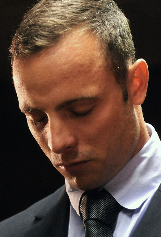 . Olympic athlete, Oscar Pistorius , in court Friday Feb. 22, 2013 in Pretoria, South Africa, for his bail hearing charged with the shooting death of his girlfriend, Reeva Steenkamp. The defense and prosecution both completed their arguments with the magistrate soon to rule if the double-amputee athlete can be freed before trial or if he must stay behind bars pending trial. (AP Photo)