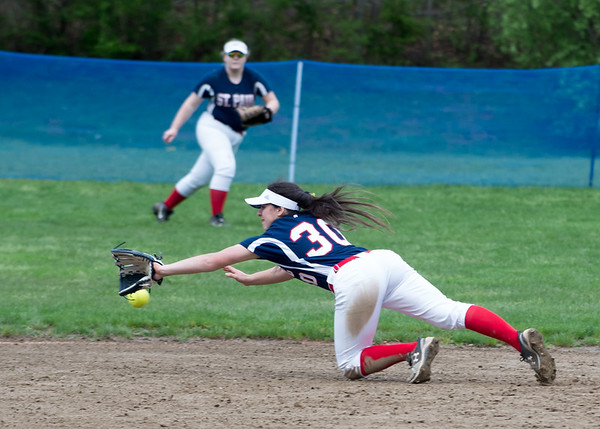 05/6/19 Wesley Bunnell | Staff St. Paul Catholic softball vs Torrington on Senior Day on Monday afternoon. Jessica Persechino (30) dives but is unable to come up with a hard hit ball.