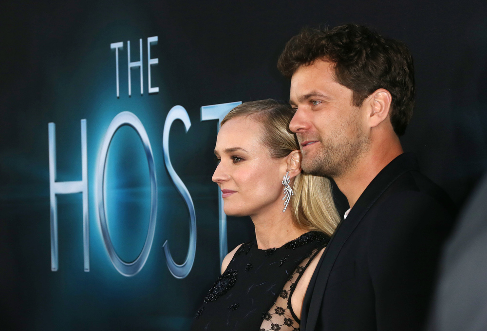 """. Actress Diane Kruger (L) and Joshua Jackson attend the Premiere of Open Roads Films \""""The Host\"""" at the ArcLight Cinemas Cinerama Dome on March 19, 2013 in Hollywood, California.  (Photo by Frederick M. Brown/Getty Images)"""