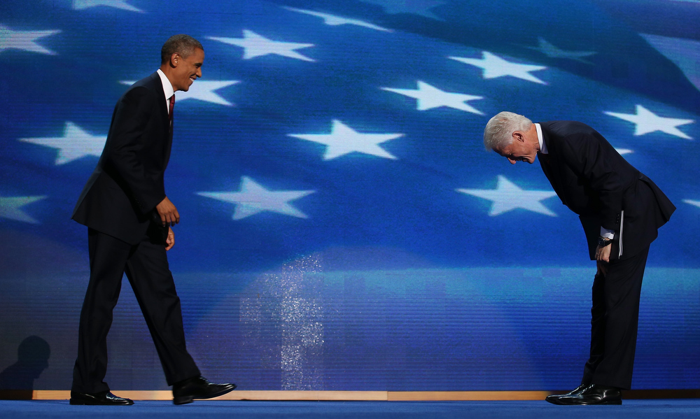 Description of . Former U.S. President Bill Clinton greets Democratic presidential candidate, U.S. President Barack Obama (L) on stage during day two of the Democratic National Convention at Time Warner Cable Arena on September 5, 2012 in Charlotte, North Carolina. The DNC that will run through September 7, will nominate U.S. President Barack Obama as the Democratic presidential candidate.  (Photo by Chip Somodevilla/Getty Images)