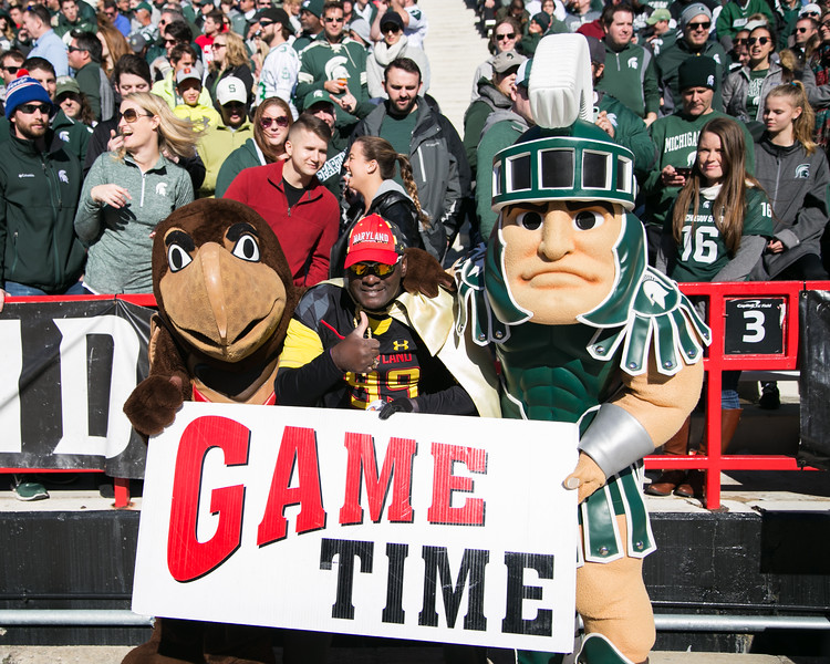 Testudo, Special K, and Sparty come together for a friendly photo