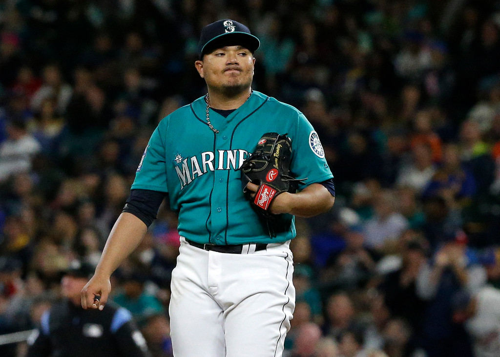 . Seattle Mariners starting pitcher Erasmo Ramirez reacts on the mound after Cleveland Indians\' Giovanny Urshela hit a solo home run in the third inning of a baseball game, Friday, Sept. 22, 2017, in Seattle. (AP Photo/Ted S. Warren)