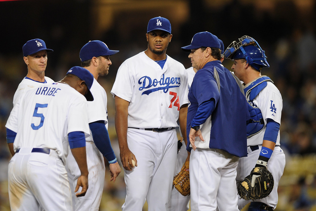 . Dodgers closer Kenley Jansen gets a visit from pitching coach Rick Honeycutt after giving up the tying run in the ninth-inning, Thursday, September 12, 2013, at Dodger Stadium. (Photo by Michael Owen Baker/L.A. Daily News)
