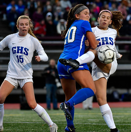 11/23/2019 Mike Orazzi | Staff Southington High School's Katherine Crouse (20) and Glastonbury's Alexandra Bedard (29) during the Class LL Girls State Soccer Tournament at Veterans Stadium in New Britain Saturday evening. Glastonbury won 1-0.