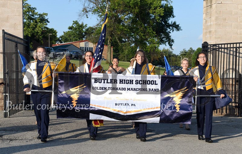 Harold Aughton/Butler Eagle: The Butler High School Marching Band enters the football stadium doning their new uniforms Wednesday, August 21.