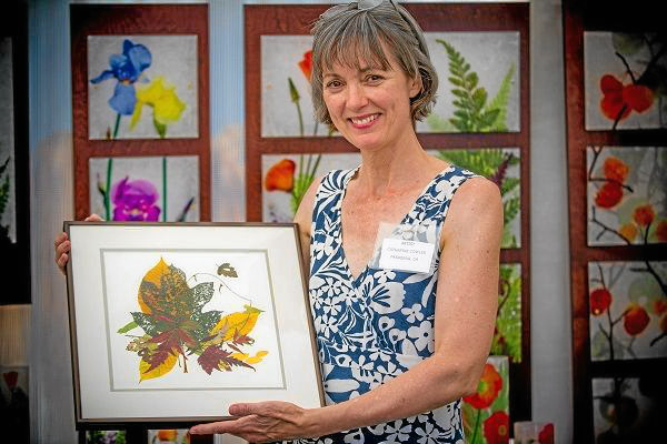 . Pasadena artist Catherine Cowles holds her work during Art on the Lake XIV at the Bartlett Events Center in Big Bear Lake, Saturday , Aug. 17, 2013.  (Photo by Eric Reed for The Sun)