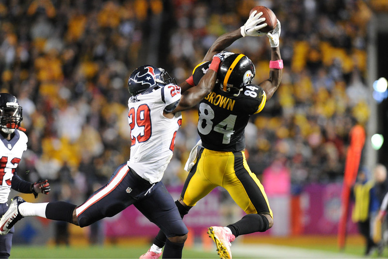 . Pittsburgh Steelers wide receiver Antonio Brown (84) makes a catch past Houston Texans defensive back Andre Hal (29) in the fourth quarter of the NFL football game, Monday, Oct. 20, 2014, in Pittsburgh. (AP Photo/Don Wright)