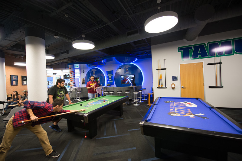 Students enjoy the Breakers Lounge by playing a game of pool.