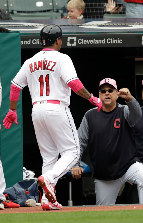 . Cleveland Indians manager Terry Francona, right, congratulates Jose Ramirez after Ramirez hit a three run home run in the second inning of a baseball game against the Kansas City Royals, Sunday, May 13, 2018, in Cleveland. (AP Photo/Tony Dejak)
