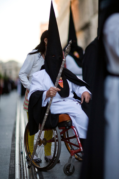 Physically handicapped penitent on a wheelchair, Holy Week 2008, Seville, Spain