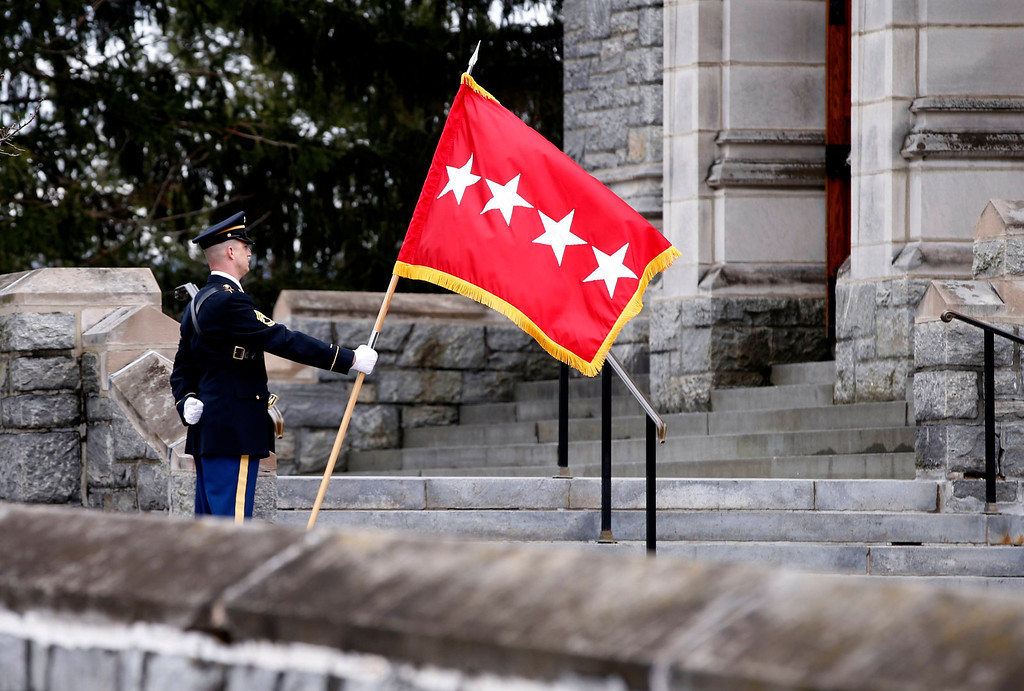 . A U.S. Army soldier holds a four star flag outside the Cadet Chapel during the funeral service for the late U.S. Four Star General H. Norman Schwarzkopf at the United States Military Academy at West Point, New York, February 28, 2013. Schwarzkopf, who graduated from West Point in 1956, commanded the U.S.-led international coalition that drove Saddam Hussein\'s forces out of Kuwait in 1991. He was 78 when he died in Tampa, Florida on December 27, 2012 of complications from pneumonia. REUTERS/Mike Segar