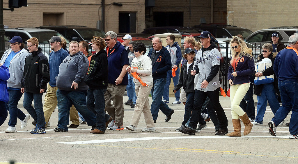 . Fans head to Comerica Park for the start of Game 3 of the ALDS between the Tigers and Oakland A\'s, Monday October 7, 2013. (Oakland Press Photo:Vaughn Gurganian)