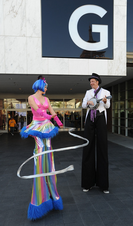 . Stilt walkers Buffy Hornung and Paul Newman welcome shoppers to the Glendale Galleria. The mall has completed a major renovation and is celebrating this weekend with a grand re-opening. Glendale, CA. 11/8/2013. photo by (John McCoy/Los Angeles Daily News)