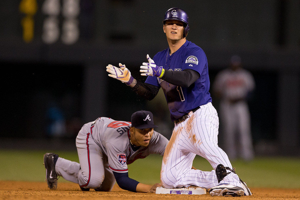 . Brandon Barnes #1 of the Colorado Rockies celebrates after his two-out double as Andrelton Simmons #19 of the Atlanta Braves applies the tag late during the seventh inning at Coors Field on June 9, 2014 in Denver, Colorado.  (Photo by Justin Edmonds/Getty Images)
