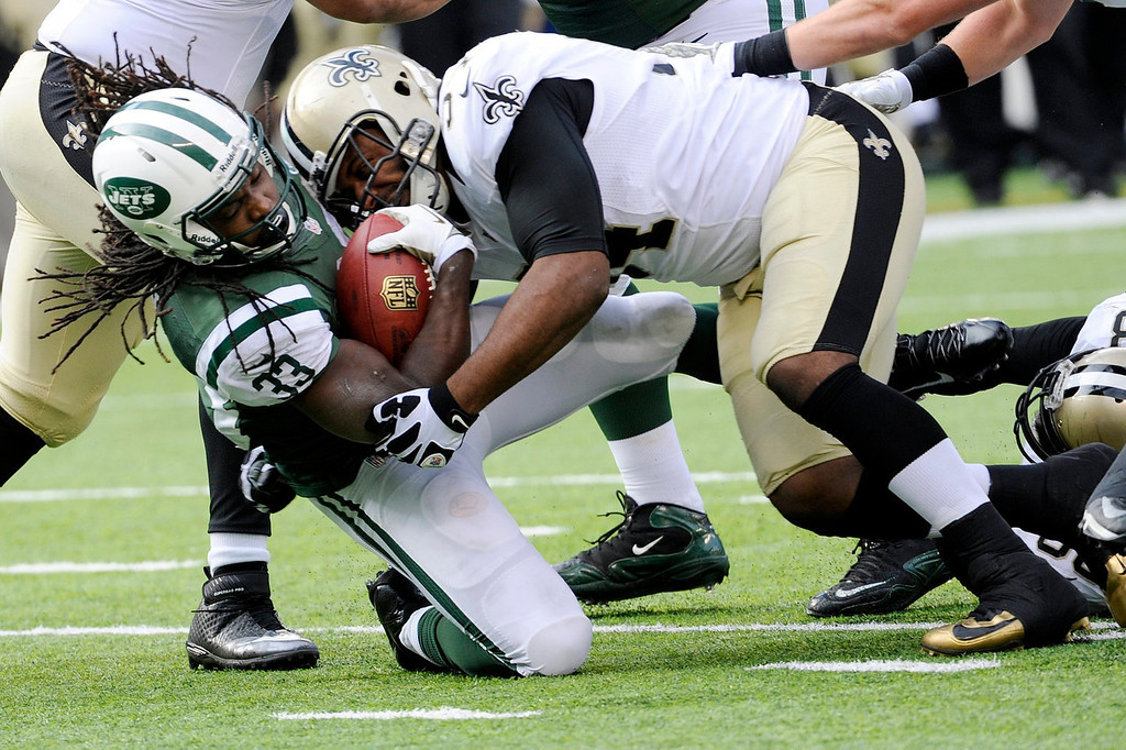 . New Orleans Saints\' Will Herring (54) tackles New York Jets\' Chris Ivory (33) during the first half of an NFL football game Sunday, Nov. 3, 2013, in East Rutherford, N.J.  (AP Photo/Bill Kostroun)