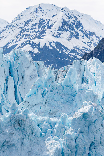 A large block of ice calves off of Margarie Glacier in Glacier Bay National Park, Alaska