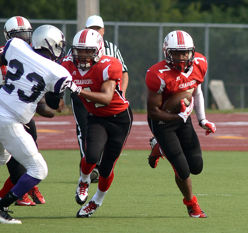 . Southfield-Lathrup\'s #7 Adrian Church rumbles for yardage against Pontiac High School during their game at Southfield Lathrup High School, Thursday August 29, 2013. (Oakland Press Photo:Vaughn Gurganian)