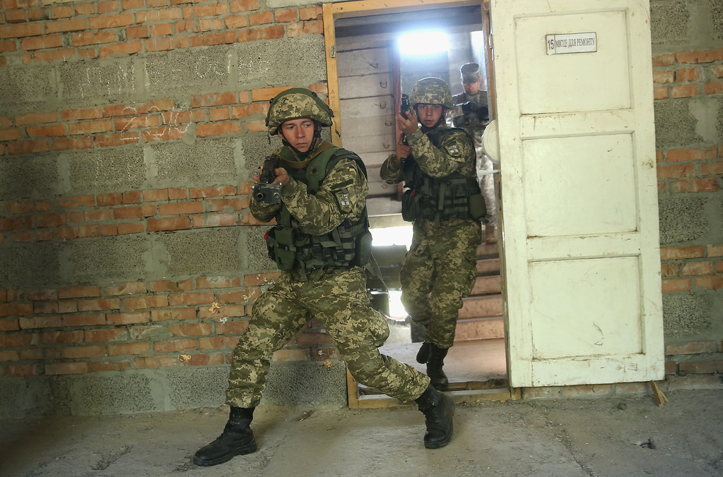". Ukrainian marines practice urban warfare techniques following instruction from U.S. soldiers on the second day of the ""Rapid Trident\"" NATO military exercises on September 16, 2014 near Yavorov, Ukraine.  (Photo by Sean Gallup/Getty Images)"