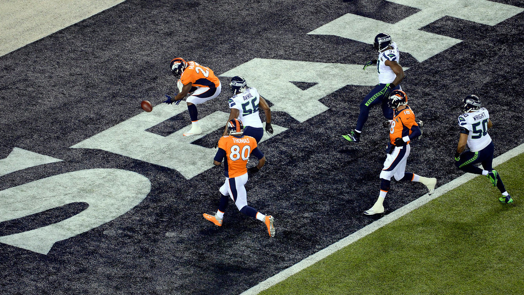 . Denver Broncos running back Knowshon Moreno (27) scrambles for the ball during a safety on the opening play.  The Denver Broncos vs the Seattle Seahawks in Super Bowl XLVIII at MetLife Stadium in East Rutherford, New Jersey Sunday, February 2, 2014. (Photo by Craig F. Walker/The Denver Post)