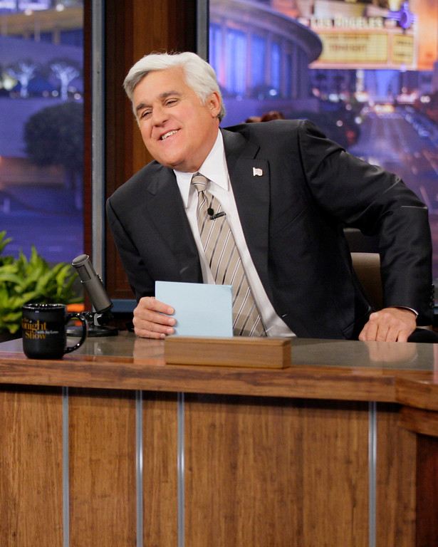 """. This Oct. 24, 2012 photo released by NBC shows Jay Leno, host of \""""The Tonight Show with Jay Leno,\"""" on the set in Burbank, Calif. NBC announced Wednesday, April 3, 2013 that Jimmy Fallon is replacing Jay Leno as the host of \""""The Tonight Show\"""" in spring 2014. (AP Photo/NBC, Paul Drinkwater)"""