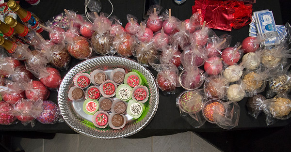 12/12/19 Wesley Bunnell | StaffrrMrs Keith Candy Apples and candy with a table full of sweets for sale at the Holiday Craft Fair at 1 Liberty Square on Thursday afternoon.