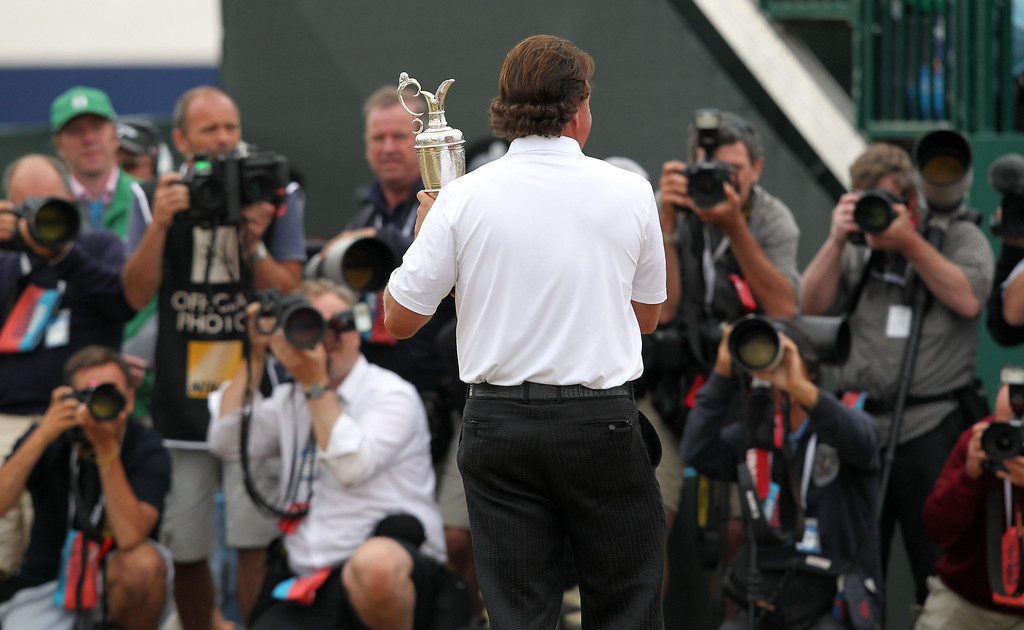 . US golfer Phil Mickelson poses for pictures with the Claret Jug after winning the 2013 British Open Golf Championship at Muirfield golf course at Gullane in Scotland on July 21, 2013. Mickelson won the British Open at Muirfield with a superb final round of 66. The 43-year-old American won with a three under total of 281, three strokes clear of Henrik Stenson who had a closing 70.     PETER MUHLY/AFP/Getty Images