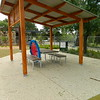 timber post and rail with steel roof shade structure and picnic table and benches