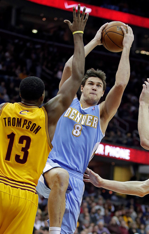 . Denver Nuggets\' Danilo Gallinari (8), from Italy, shoots over Cleveland Cavaliers\' Tristan Thompson (13) in the first quarter of an NBA basketball game Saturday, Feb. 9, 2013, in Cleveland. (AP Photo/Mark Duncan)