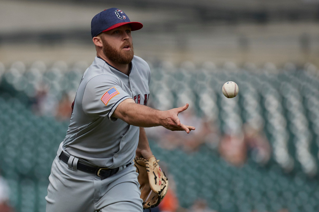. Cleveland Indians relief pitcher Cody Allen underhands the ball to first for the final out in the ninth inning against the Detroit Tigers of a baseball game in Detroit, Sunday, July 2, 2017. Cleveland won 11- 8. (AP Photo/Rick Osentoski)