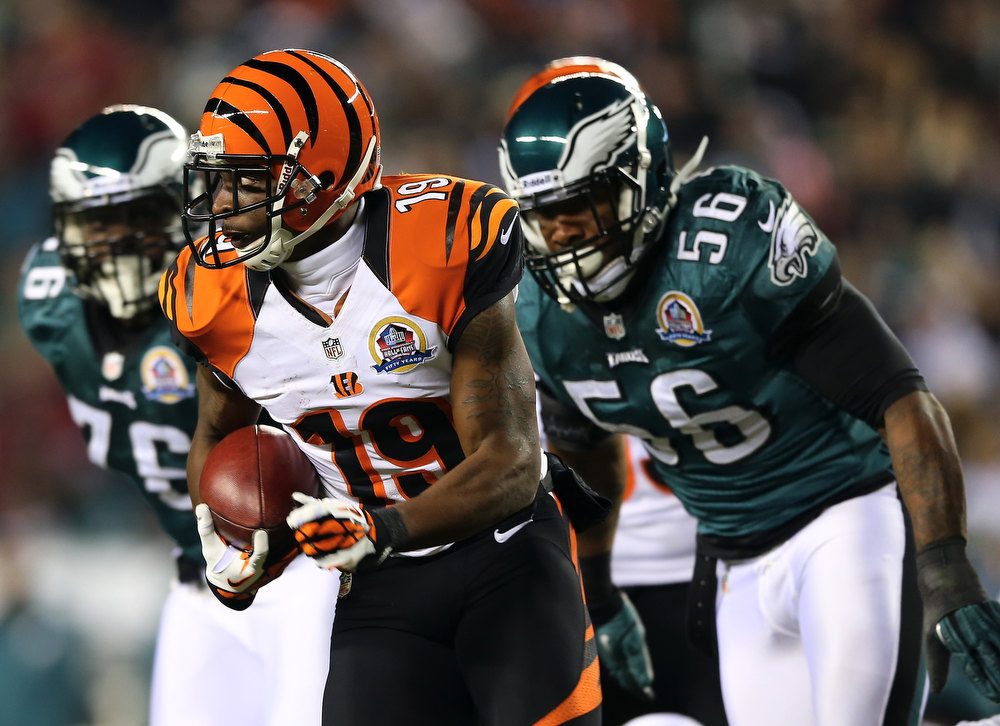 . Brandon Tate #19 of the Cincinnati Bengals carries the ball as Akeem Jordan #56 of the Philadelphia Eagles defends on December 13, 2012 at Lincoln Financial Field in Philadelphia, Pennsylvania.  (Photo by Elsa/Getty Images)