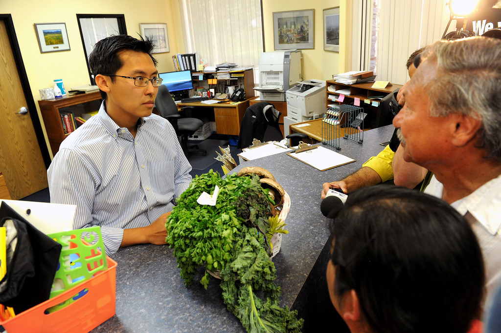 . Arturo Rodriguez, UFW president, right, presents a box of produce to Vince Fong, district director for Congressman Kevin McCarthy in McCarthy\'s office in Bakersfield, Wednesday, August 14, 2013. (Michael Owen Baker/L.A. Daily News)