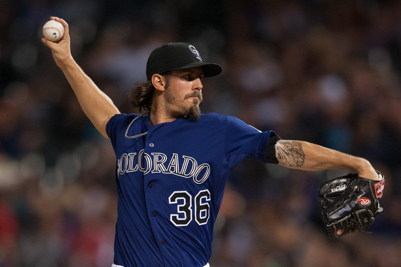 . Christian Bergman #36 of the Colorado Rockies pitches against the Los Angeles Dodgers during a game at Coors Field on September 15, 2014 in Denver, Colorado.  (Photo by Dustin Bradford/Getty Images)