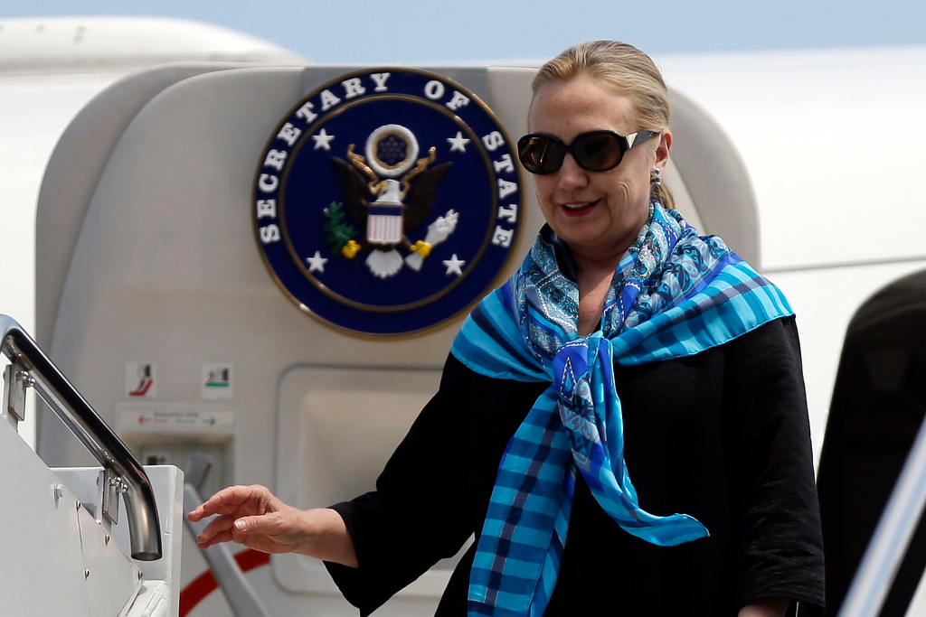 . U.S. Secretary of State Hillary Rodham Clinton steps out the airplane upon arrival at Paya Lebar Air Base, Friday, Nov. 16, 2012, in Singapore. (AP Photo/Matt Rourke, Pool)