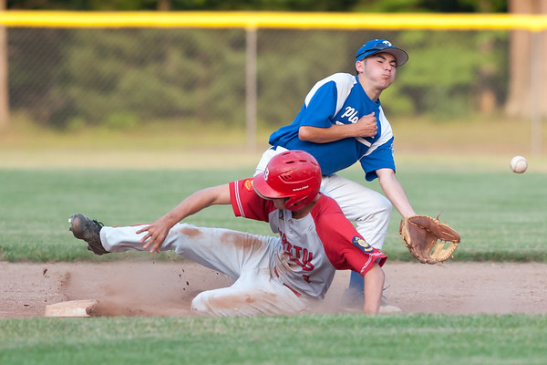 07/16/18 Wesley Bunnell | Staff Bristol defeated Plainville in legion baseball on Monday night at Trumbull Park in Plainville. Bristol runner Michael Lemke (1) slides safely in to second and would advance to third after the ball got past Riley Millette (4) and into center field.