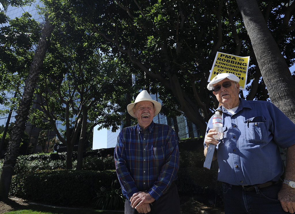 . LONG BEACH, CALIF. USA -- Retired clerks Jerry Brady, left, and Jerry Garretson protest the Pacific Maritime Association (PMA) handling of their health care benefits on Monday, July 8, 2013, in Long Beach, Calif.  Photo by Jeff Gritchen / Los Angeles Newspaper Group